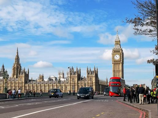 Canva LONDON, ENGLAND, UK SEPTEMBER 17, 2015 A Double Decker Bus With Big Ben In London, Uk