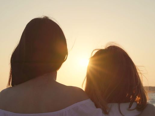 Canva Young Asian Lesbian Couple Kissing Near Beach. Beautiful Women Lgbt Couple Happy Relax Enjoy Love And Romantic Moment When Sunset In Evening. Lifestyle Lesbian Couple Travel On Beach Concept.
